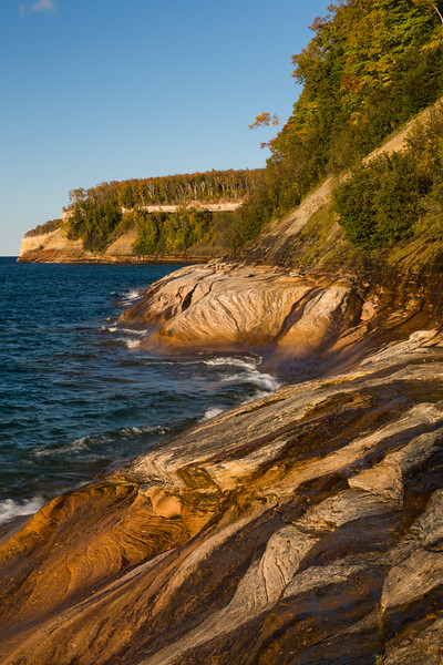 Late afternoon light shines on the cliffs of Picture Rocks National Lakeshore, MI<br /> <br /> MI-120929-0159