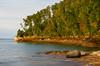Evening light illuminates the shore in Miners Beach. PIctured Rocks National Lakeshore, MI<br /> <br /> MI-080925-0113