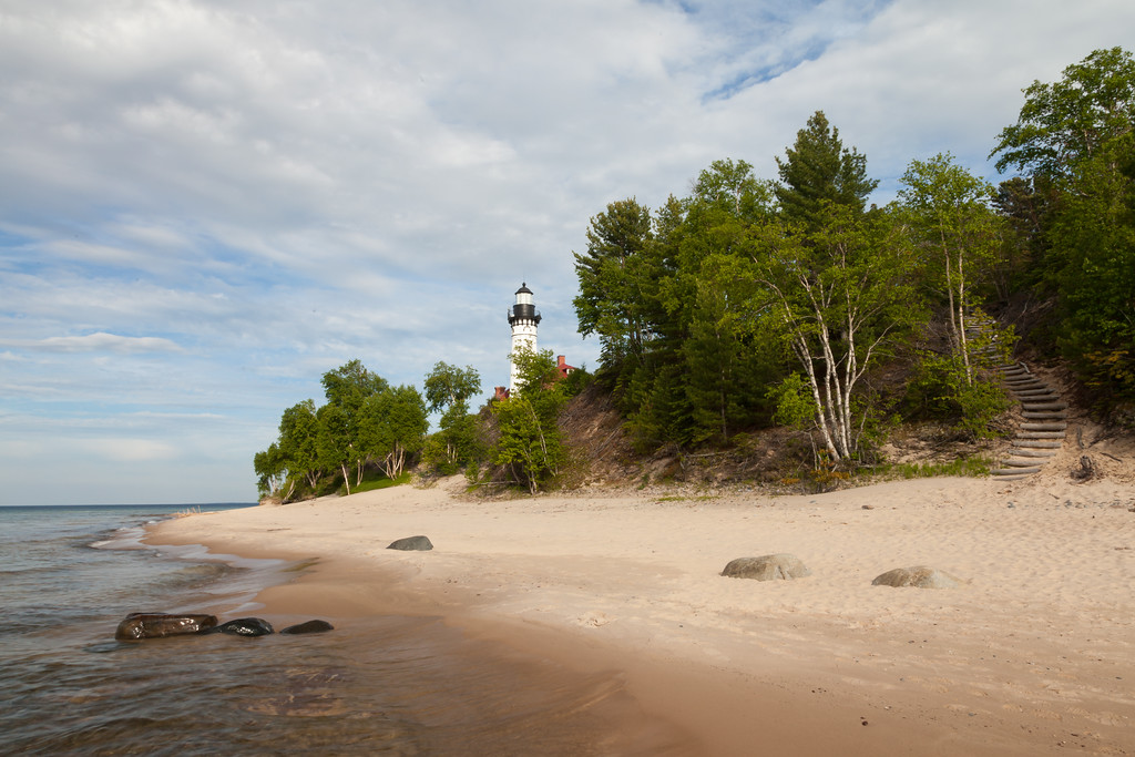 The Au Sable Point Lighthouse rises above the shoreline Lake Superior. Pictured Rocks National Lakeshore, MI<br /> <br /> MI-090622-0027