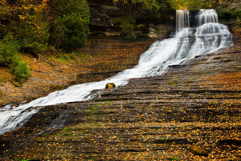 Fallen leafs cover the limestone around Laughing Whitefish Falls. Alger County, MI<br /> <br /> MI-141002-0135