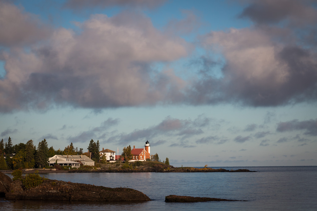 Clouds move over the Eagle Harbor lighthouse during a crisp fall morning. Eagle Harbor, MI<br /> <br /> MI-120929-0044