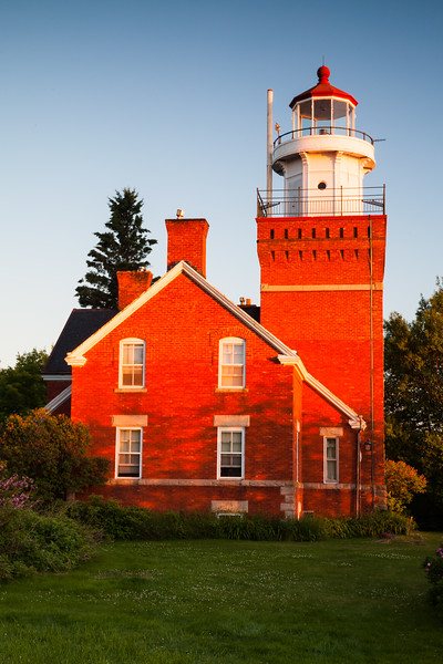 The Big Bay Lighthouse glows orange during sunrise. Big Bay, MI<br /> <br /> MI-110704-0006
