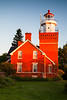 The Big Bay Lighthouse glows orange during sunrise. Big Bay, MI<br /> <br /> MI-110704-0006