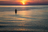 A fisherman tests his luck at sunset on the shores of Lake Superior. Porcupine Mountains Wilderness State Forers, MI<br /> <br /> MI-120927-0060