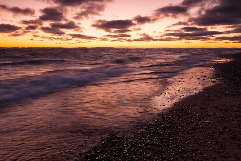 The Lake Superior horizon glows as sunrise approaches. Paradise, MI<br /> <br /> MI-111001-0015