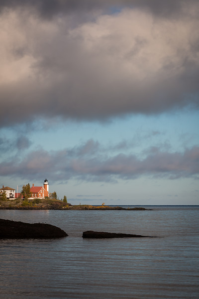Clouds move over the Eagle Harbor lighthouse during a crisp fall morning. Eagle Harbor, MI<br /> <br /> MI-120929-0056