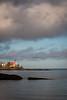 Clouds move over the Eagle Harbor lighthouse during a crisp fall morning. Eagle Harbor, MI<br /> <br /> MI-120929-0056