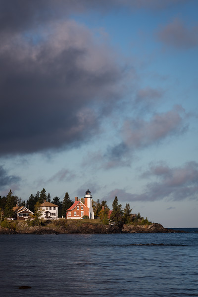 Clouds move over the Eagle Harbor lighthouse during a crisp fall morning. Eagle Harbor, MI<br /> <br /> MI-120929-0067