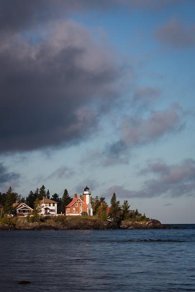 Clouds move over the Eagle Harbor lighthouse during a crisp fall morning. Eagle Harbor, MI<br /> <br /> MI-120929-0067