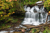 Early Fall color surrounds the water flowing down Wegner Falls. Munising, MI<br /> <br /> MI-080928-0048