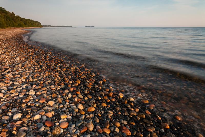 Rocky Lake Superior beach near Point Iroquois. Bay Mills, MI<br /> <br /> MI-110707-0032