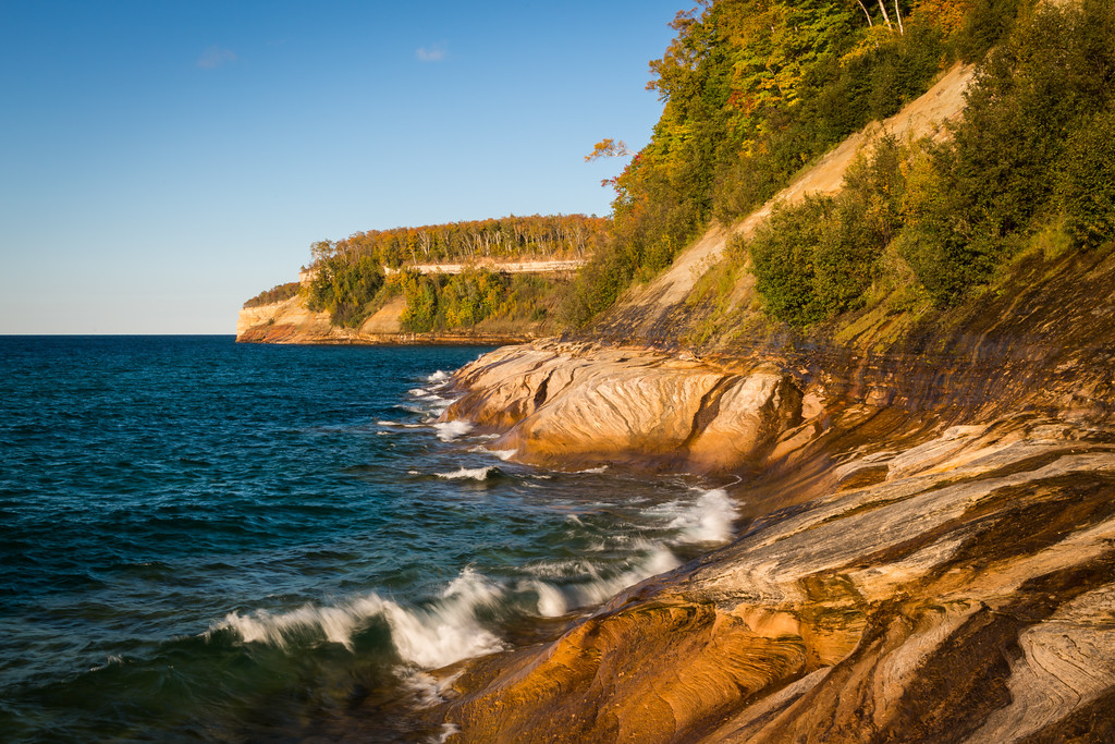 Late afternoon light shines on the cliffs of Picture Rocks National Lakeshore, MI<br /> <br /> MI-120929-0158