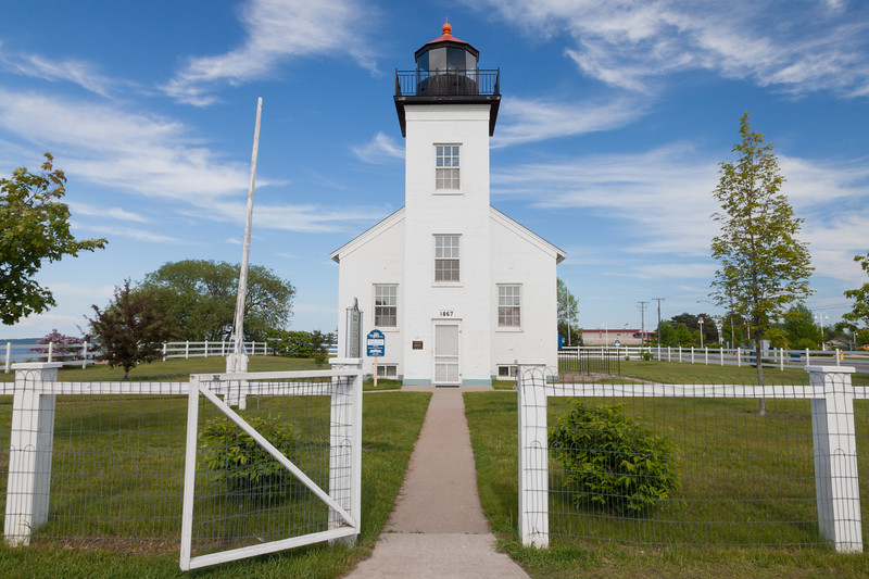 The Sand Point Lighthouse warned the ships approaching escanaba from 1868 to 1939. Throughout its history, the lighthouse underwent several modification. After extensive rennovations, the building was restored to its original appearance. Escanaba, MI<br /> <br /> MI-090621-0024