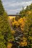 A bridge over the Ontonagon River with fall foliage color near Agate Falls, Michigan, USA.