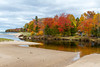 The Lake Superior shore with fall foliage color in the Upper Peninsula, Michigan, USA.