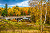Fall foliage color and a bridge in rural Michigan, Upper Peninsula, USA.