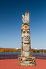 Wood craving of Indian totem pole at lakeside in Wakefield, Michigan, USA.