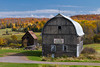 A barn with fall foliage color in rural Michigan, Upper Peninsula, USA.