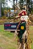 Fall scarecrow mailbox decor in rural Upper Peninsula, Michigan, USA.