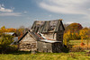 Old farm buildings with fall foliage color in rural Michigan, Upper Peninsula, USA.