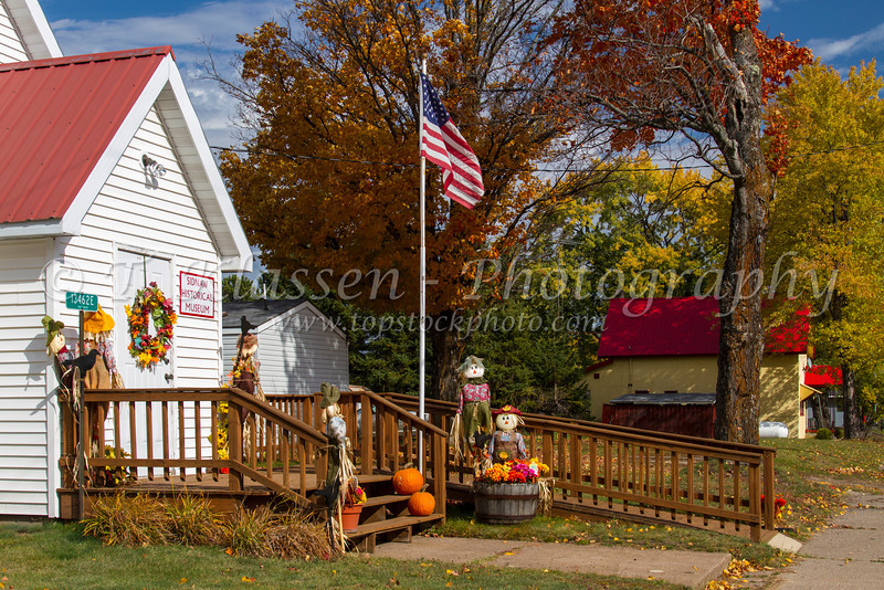 Fall decor of scarecrows at the Historical Museum in Sidnaw, Michigan, USA.