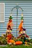 Fall scarecrow decor in rural Upper Penninsula, Michigan, USA.