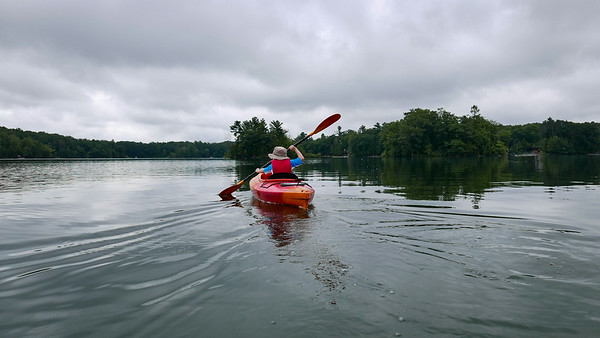 Emmett paddles across  Bass Lake in search of turtles and frogs.