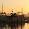 Boats at sunrise, west bay, Traverse City