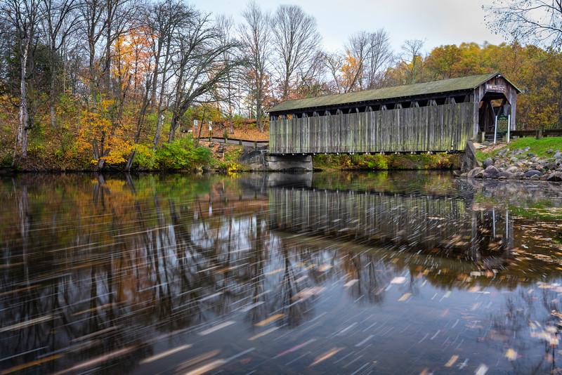 Leaves streak by in the Flat River in Fallasburg Park.  Lowell, MI