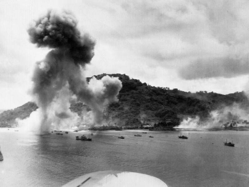 A column of smoke rises high in the air from the Japanese Naval Base on Dublon (now Tonowas) Island in the Chuuk Lagoon, during the U.S. Navy's carrier-based bomber attack on April 30, 1944 (A.P. wirephoto from the U.S. Navy)