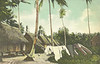 Colorized photograph of houses and clothes drying in the leper colony on Guam, circa 1910