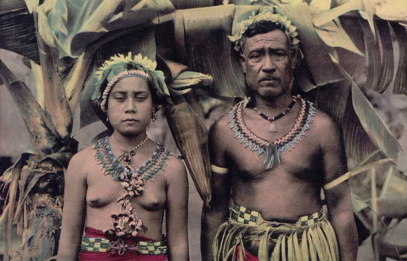 Colorized photograph of a chief and his daughter on Saipan, during the period of Japan's South Seas Mandate (about 1920)