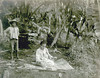 Kosrae, 1899:  Henry Clifford Fassett photograph of a young woman preparing banana fiber for weaving; a young boy stands nearby