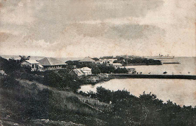 Postcard photograph from the period of German rule, showing the district offices and cable station of the German-Netherlands Telegraph Company in Colonia, Yap, circa 1900