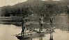 Three young Yapese men on a raft in Chamorro Bay, Yap, circa, 1929.