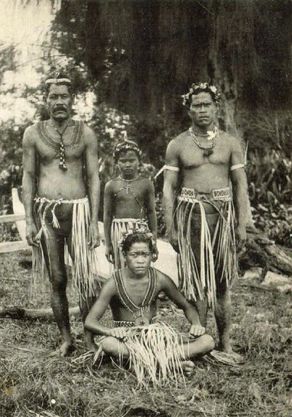 On Saipan, men and boys in traditional dress, about 1920