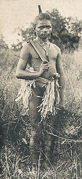 From a 1909 German postcard, a photograph of a Yapese man in traditional dresss