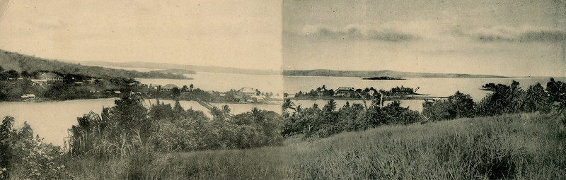 A composite of the second two of the preceding triptych of photos of Colonia's Chamorro Bay, from the hill to the south, about 1930