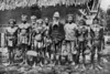 On Koror, a group of Palauan chiefs, with the 'aybathul' or paramount chief, wearing a hat, in the center (Junius B. Wood, 1921)