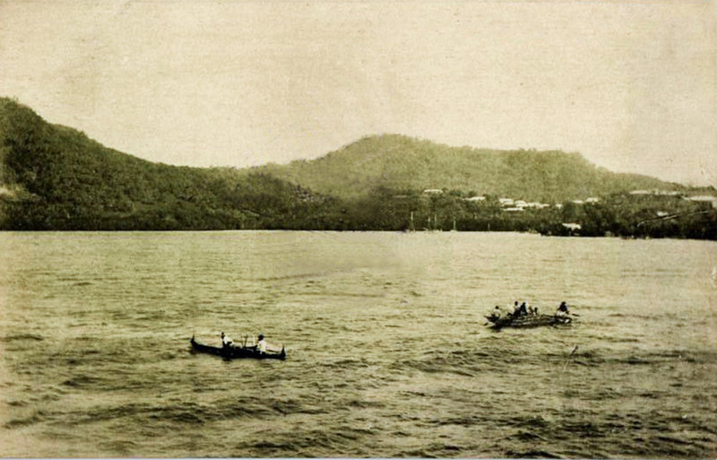 Two Chuukese outrigger canoes in Dublon (now 'Tonowas') Harbor, circa 1930