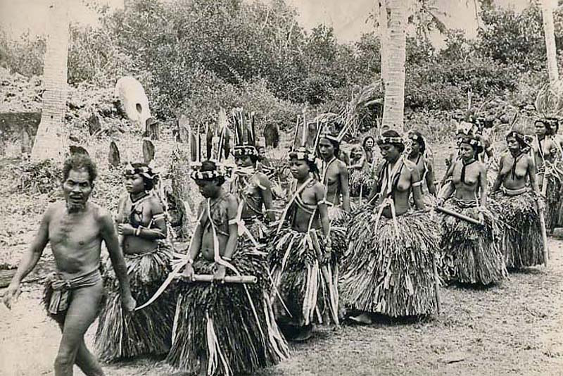 Yap, 1949:  Leading in a procession of women preparing to dance