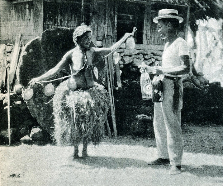 "From ""The Illustrated London News"" of 24 April 1937:  ""The Queen of Yap paying a Chamorro trader a string of oyster-shells (worth 20 cents) for two bottles of petroleum; handier money than the big stones (seen behind to the left)."""