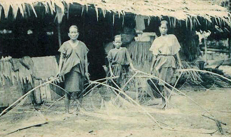 From the period of Japan's South Seas Mandate, two Chuukese women and a girl with fishing nets, about 1930