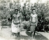 Pohnpei, 1899:  Photograph by Henry Clifford Fassett of two armed young men in traditional clothes and ornaments