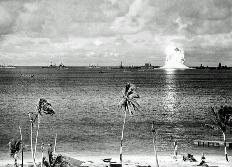 "Underwater fission implosion of  Plutonium 239 bomb ""Baker"" in the  Bikini Atoll Lagoon on July 24, 1946.  The ships in the lagoon were there so that the effects of the bomb on them could be studied.  Eight of the ships were sunk or capsized; eight more were severely damaged.  The photo was taken at the 0.5-second point of the bomb's detonation"