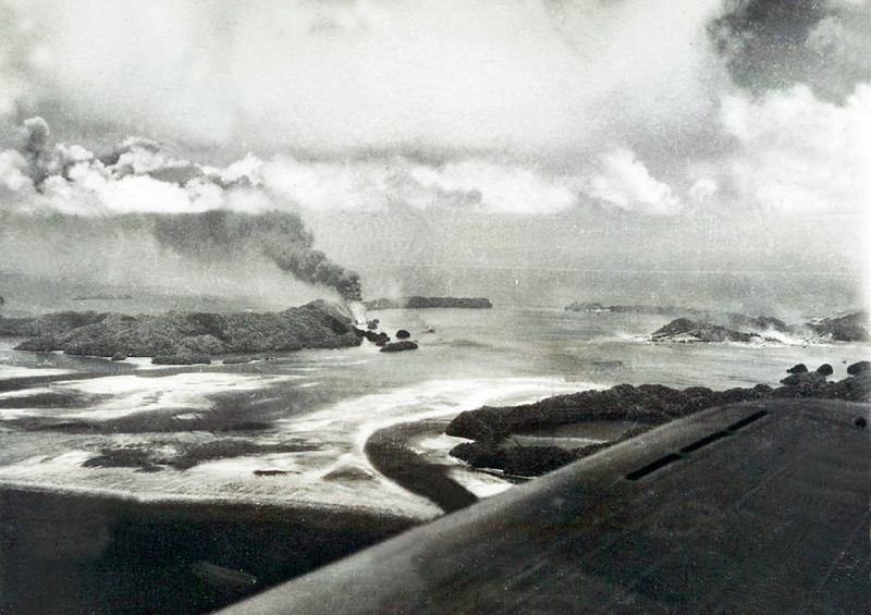 "Another photo of the aftermath of the U.S. attack on Japanese bases in and around Koror on 29-30 March 1944.  The press release caption for the photo reads, in part: ""The most powerful task force ever to operate in the Central Pacific strikes a blow at the strategic Japanese bases only 600 miles from the Philippines. Unchallenged by the Japanese fleet, the task force wreaked havoc on Palau and adjacent enemy bases, sinking 28 ships and damaging or destroying 140 Japanese planes. Only 25 of the hundreds of American planes in the task force were lost."""