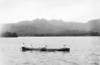 Kosrae, 1899:  Photograph by Henry Clifford Fassett showing four men rowing an outrigger canoe