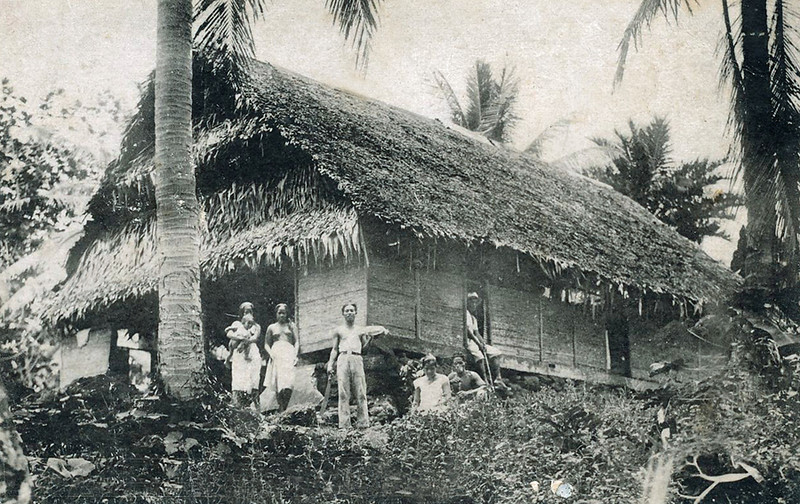 A Pohnpeian family in front of their house (photo from the period of Japan's South Seas Mandate)