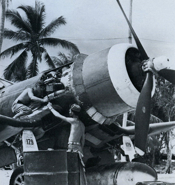 Marine mechanics working on the engine of a Corsair fighter on Ulithi (U.S. Navy, National Archives)