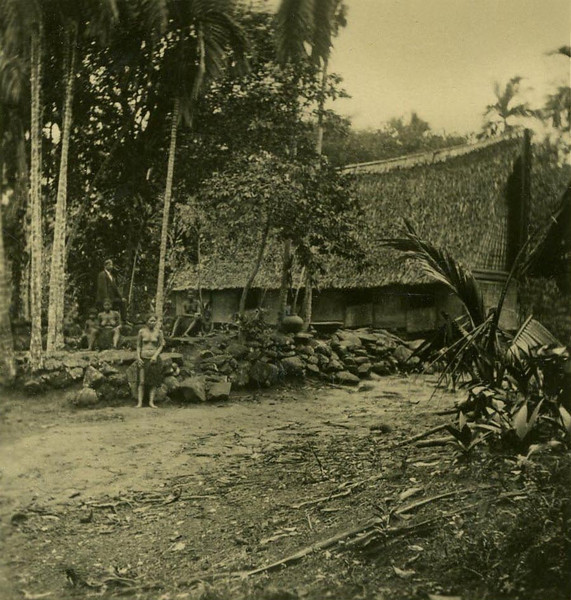 "Three women, a child, and a man in Western dress outside the ""King's"" house, Koror (Kurt Boeck, 1900)"